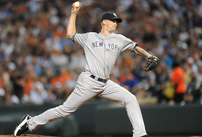 BALTIMORE, MD - AUGUST 26:  A.J. Burnett #34 of the New York Yankees pitches during a baseball game against the Baltimore Orioles at Oriole Park at Camden Yards on August 26, 2011 in Baltimore, Maryland.  (Photo by Mitchell Layton/Getty Images)