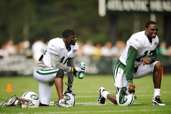 FLORHAM PARK, NJ - AUGUST 07:  Santonio Holmes #10 of the New York Jets talks with Plaxico Burress #17 at NY Jets Practice Facility on August 7, 2011 in Florham Park, New Jersey.  (Photo by Patrick McDermott/Getty Images)