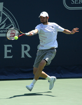 LOS ANGELES, CA - JULY 30:  Mardy Fish hits a return to Ryan Harrison in the semifinals during Day 6 of the Farmers Classic presented by Mercedes-Benz at the LA Tennis Center on July 30, 2011 in Los Angeles, California. Fish won 6-0, 4-6, 7-6 (3).  (Photo