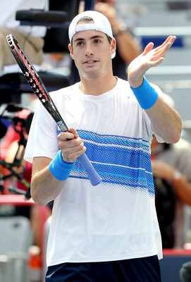 MONTREAL, QC - AUGUST 10:  John Isner of the United States acknowledges the crowd after his win over Marcos Baghdatis of Cyprus during the Rogers Cup at Uniprix Stadium on August 10, 2011 in Montreal, Canada.  (Photo by Matthew Stockman/Getty Images)