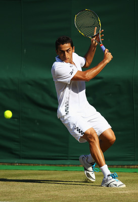 LONDON, ENGLAND - JUNE 25:  Nicolas Almagro of Spain in action during his third round match against  Mikhail Youzhny of Russia on Day Six of the Wimbledon Lawn Tennis Championships at the All England Lawn Tennis and Croquet Club on June 25, 2011 in London