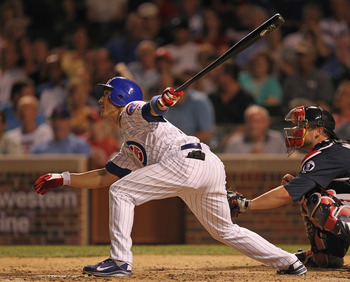 CHICAGO, IL - AUGUST 24:  Darwin Barney #15 of the Chicago Cubs hits the ball against the Atlanta Braves at Wrigley Field on August 24, 2011 in Chicago, Illinois. The Cubs defeated the Braves 3-2.  (Photo by Jonathan Daniel/Getty Images)