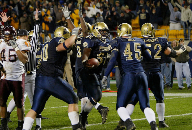 PITTSBURGH - NOVEMBER 8:  Lousaka Polite #32 of the University of Pittsburgh Panthers celebrates with his teammates after he scored the game winning touchdown in the final minute as the Panthers defeated the Virginia Tech Hokies 31-28 during NCAA football