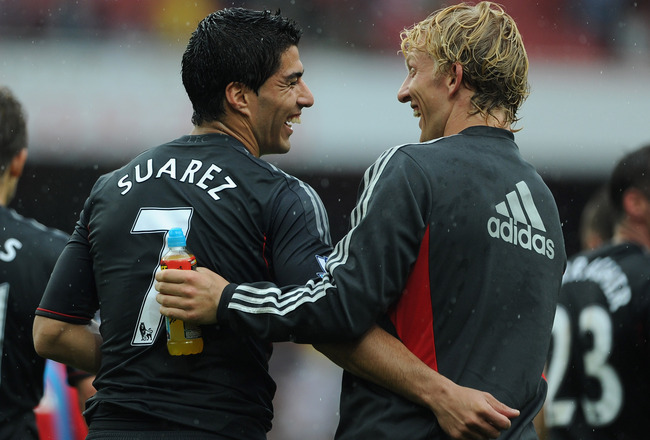 LONDON, ENGLAND - AUGUST 20:  Luis Suarez and Dirk Kuyt of Liverpool share a joke as they celebrate victory after the Barclays Premier League match between Arsenal and Liverpool at the Emirates Stadium on August 20, 2011 in London, England.  (Photo by Mic