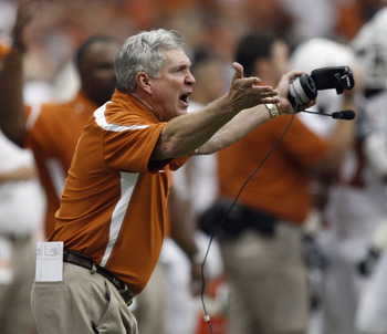 HOUSTON - SEPTEMBER 04:  Mack Brown, head coach of the Texas Longhorns yells at the officials after a delay of game was called in the third quarter during a game against the Rice Owls at Reliant Stadium on September 4, 2010 in Houston, Texas. Texas beat R