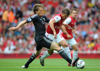 LONDON, ENGLAND - AUGUST 20:  Leiva Lucas of Liverpool tackles Andrey Arshavin of Arsenal during the Barclays Premier League match between Arsenal and Liverpool at the Emirates Stadium on August 20, 2011 in London, England.  (Photo by Michael Regan/Getty