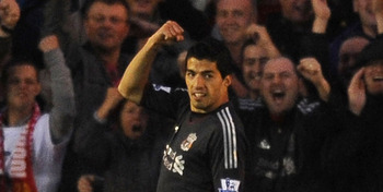 EXETER, ENGLAND - AUGUST 24:  Luis Suarez of Liverpool celebrates scoring their first goal during the Carling Cup second Round match betweem Exeter City and Liverpool at St. James Park on August 24, 2011 in Exeter, England.  (Photo by Christopher Lee/Gett