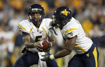 CINCINNATI - NOVEMBER 17: Patrick White #5 of the West Virginia Mountaineers hands off the ball to Steve Staton #10 during the Big East Conference game against the Cincinnati Bearcats at Nippert Stadium November 17, 2007 in Cincinnati, Ohio. (Photo by And
