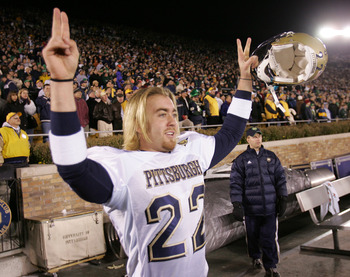 SOUTH BEND, IN - NOVEMBER 13: Kicker Josh Cummings #22 of Pittsburgh celebrates a win over Notre Dame after a game on November 13, 2004 at Notre Dame Stadium in South Bend, Indiana. Cummings kicked the game-winning field goal as Pittsburgh defeated Notre