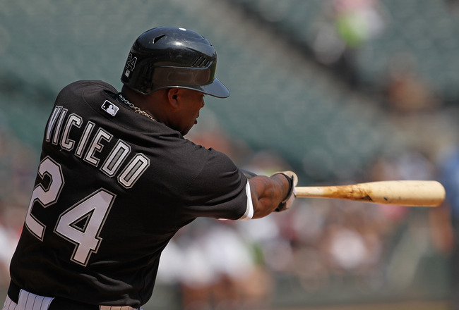CHICAGO, IL - AUGUST 31: Dayan Viciedo #24 of the Chicago White Sox hits a single against the Minnesota Twins at U.S. Cellular Field on August 31, 2011 in Chicago, Illinois. (Photo by Jonathan Daniel/Getty Images)