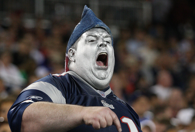 FOXBORO, MA - SEPTEMBER 1:  A fan of the New England Patriots shows his support  against  Michael Coe #37 of the New York Giants at Gillette Stadium on September 1, 2011 in Foxboro, Massachusetts. (Photo by Jim Rogash/Getty Images)