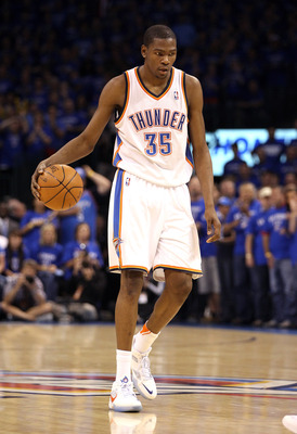 OKLAHOMA CITY, OK - MAY 23:  Kevin Durant #35 of the Oklahoma City Thunder moves the ball while taking on the Dallas Mavericks in Game Four of the Western Conference Finals during the 2011 NBA Playoffs at Oklahoma City Arena on May 23, 2011 in Oklahoma Ci