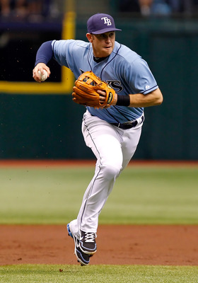 ST. PETERSBURG, FL - AUGUST 21:  Infielder Evan Longoria #3 of the Tampa Bay Rays throws over to first for an out against the Seattle Mariners during the game at Tropicana Field on August 21, 2011 in St. Petersburg, Florida.  (Photo by J. Meric/Getty Imag