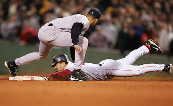 BOSTON - OCTOBER 17:  Dave Roberts #31 of the Boston Red Sox steals second base while shortstop Derek Jeter #2 of the New York Yankees applies the tag in the ninth inning during game four of the American League Championship Series on October 17, 2004 at F