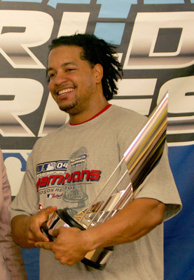 ST LOUIS - OCTOBER 27:  Manny Ramirez #24 of the Boston Red Sox is presented with the MVP trophy after defeating the St. Louis Cardinals 3-0 in game four of the World Series on October 27, 2004 at Busch Stadium in St. Louis, Missouri.  (Photo by Ezra Shaw
