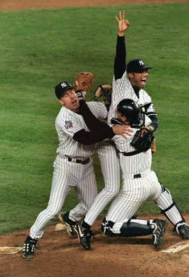 NEW YORK - OCTOBER 27:  Relief pitcher Mariano Rivera #42 of the New York Yankees celebrates with teammates Jorge Posada #20 and Scott Brosius after winning the World Series against the Atlanta Braves at Yankee Stadium on October 27, 1999 in the Bronx, Ne