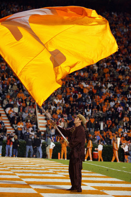KNOXVILLE, TN - OCTOBER 29:  A University of Tennessee Volunteer spirit squad member waves a flag in the end zone during a game between the Tennessee Volunteers and the University of South Carolina Gamecocks at Neyland Stadium on October 29, 2005 in Knoxv