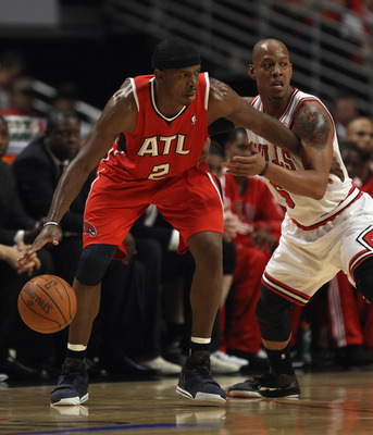 CHICAGO, IL - MAY 10: Joe Johnson #2 of the Atlanta Hawks moves against Keith Bogans #6 of the Chicago Bulls in Game Five of the Eastern Conference Semifinals in the 2011 NBA Playoffs at the United Center on May 10, 2011 in Chicago, Illinois. The Bulls de