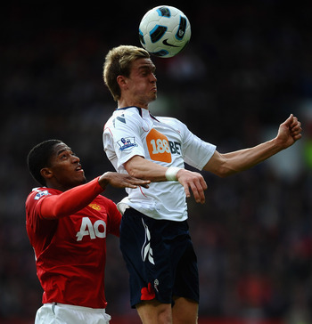 MANCHESTER, ENGLAND - MARCH 19: Antonio Valencia (L) of Manchester United battles with Stuart Holden of Bolton Wanderers during the Barclays Premier League match between Manchester United and Bolton Wanderers at Old Trafford on March 19, 2011 in Mancheste