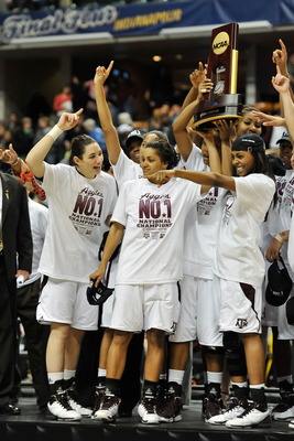 INDIANAPOLIS, IN - APRIL 5:  The Texas A&M Aggies celebrate their 76-70 win over the Notre Dame Fighting Irish in the 2011 NCAA Women's Final Four championship game at Conseco Fieldhouse on April 5, 2011 in Indianapolis, Indiana.  (Photo by Jamie Sabau/Ge