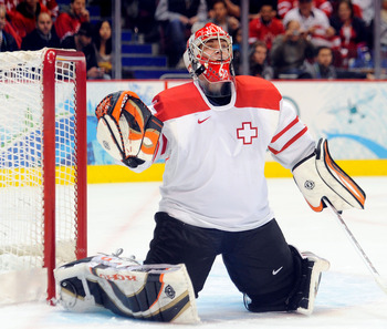 VANCOUVER, BC - FEBRUARY 24:  Jonas Hiller #1 of Switzerland tends goal during the ice hockey men's quarter final game between USA and Switzerland on day 13 of the Vancouver 2010 Winter Olympics at Canada Hockey Place on February 24, 2010 in Vancouver, Ca