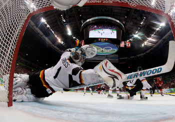 VANCOUVER, BC - FEBRUARY 23:  Thomas Greiss #1 of Germany dives to make a save during the ice hockey Men's Qualification Playoff game between Germany and Canada on day 12 of the Vancouver 2010 Winter Olympics at UBC Thunderbird Arena on February 23, 2010