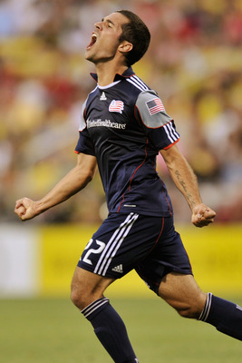 COLUMBUS, OH - AUGUST 13:  Benny Feilhaber #22 of the New England Revolution celebrates his goal late in the first half against the Columbus Crew on August 13, 2011 at Crew Stadium in Columbus, Ohio.   (Photo by Jamie Sabau/Getty Images)