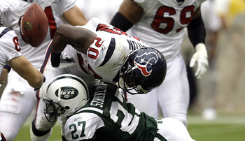 HOUSTON - SEPTEMBER 13: Running back Steve Slaton #20 of the Houston Texans fumbles the ball as he is hit by cornerback Donald Strickland #27 of the New York Jets at Reliant Stadium on September 13, 2009 in Houston, Texas.  (Photo by Bob Levey/Getty Image