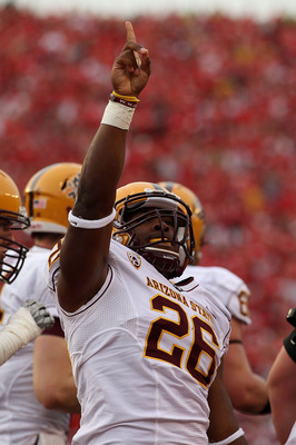 MADISON, WI - SEPTEMBER 18: Cameron Marshall #26 of the Arizona State Sun Devils celebrates scoring a touchdown in the 4th quarter against the Wisconsin Badgers at Camp Randall Stadium on September 18, 2010 in Madison, Wisconsin. Wisconsin defeated Arizon