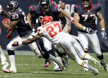 HOUSTON - OCTOBER 17:  Adrian Foster #23 of the Houston Texans runs past cornerback Donald Washington #27 of the Kansas City Chiefs at Reliant Stadium on October 17, 2010 in Houston, Texas.  (Photo by Bob Levey/Getty Images)