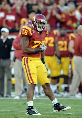 LOS ANGELES, CA - OCTOBER 30:  Marc Tyler #26 of the USC Trojans celebrates his touchdown against the Oregon Ducks at Los Angeles Memorial Coliseum on October 30, 2010 in Los Angeles, California.  (Photo by Harry How/Getty Images)