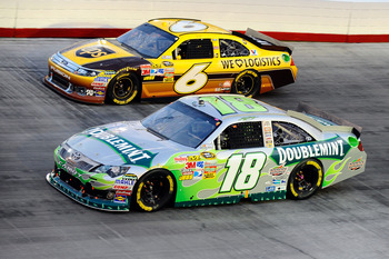 BRISTOL, TN - AUGUST 27:  Kyle Busch, driver of the #18 Wrigley's Doublemint Toyota, and David Ragan, driver of the #6 UPS Ford, race during the NASCAR Sprint Cup Series Irwin Tools Night Race at Bristol Motor Speedway on August 27, 2011 in Bristol, Tenne