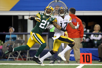 ARLINGTON, TX - FEBRUARY 06:  Charles Woodson #21 of the Green Bay Packers defends against Mike Wallace #17 of the Pittsburgh Steelers during Super Bowl XLV at Cowboys Stadium on February 6, 2011 in Arlington, Texas. The Packers won 31-25.  (Photo by Jami