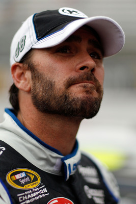 BRISTOL, TN - AUGUST 26:  Jimmie Johnson, driver of the #48 Lowe's/Kobalt Tools Chevrolet, looks on during qualifying for the NASCAR Sprint Cup Series IRWIN Tools Night Race at Bristol Motor Speedway on August 26, 2011 in Bristol, Tennessee.  (Photo by Ch