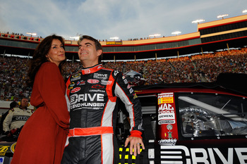 BRISTOL, TN - AUGUST 27:  Jeff Gordon, driver of the #24 Drive to End Hunger Chevrolet, stands with his wife Ingrid Vandebosch prior to the NASCAR Sprint Cup Series Irwin Tools Night Race at Bristol Motor Speedway on August 27, 2011 in Bristol, Tennessee.