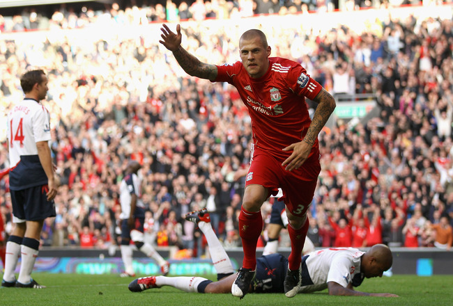 LIVERPOOL, ENGLAND - AUGUST 27:  Martin Skrtel of Liverpool celebrates scoring his side's second goal during the Barclays Premier League match between Liverpool and Bolton Wanderers at Anfield on August 27, 2011 in Liverpool, England.  (Photo by Clive Bru