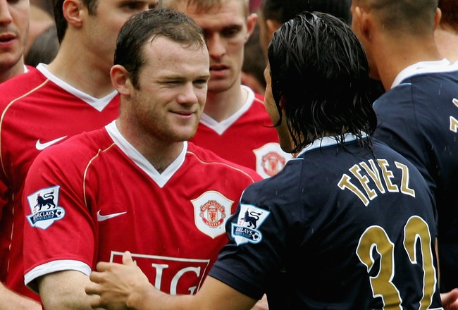 MANCHESTER, UNITED KINGDOM - MAY 13:  Wayne Rooney of Manchester United winks as he shakes hands with Carlos Tevez of West Ham United during the Barclays Premiership match between Manchester United and West Ham United at Old Trafford on May 13, 2007 in Ma