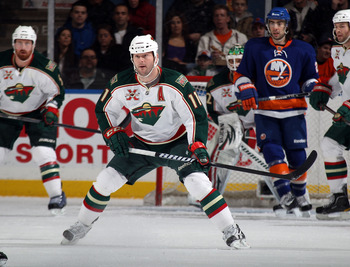 UNIONDALE, NY - MARCH 02:  John Madden #11 of the Minnesota Wild skates against the New York Islanders at the Nassau Coliseum on March 2, 2011 in Uniondale, New York. The Islanders defeated the Wild 4-1.  (Photo by Bruce Bennett/Getty Images)