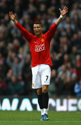 MANCHESTER, UNITED KINGDOM - NOVEMBER 15:  Cristiano Ronaldo of Manchester United celebrates  scoring the opening goal; his 100th goal for Manchester United, during the Barclays Premier League match between Manchester United and Stoke City at Old Trafford