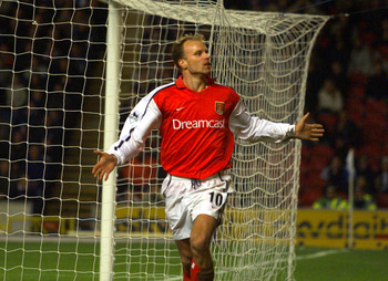 30 Jan 2002:  Dennis Bergkamp of Arsenal celebrates after scoring his second goal during the match between Blackburn Rovers and Arsenal in the FA Barclaycard Premiership at Ewood Park, Blackburn.  DIGITAL IMAGE Mandatory Credit: Laurence Griffiths/GettyIm