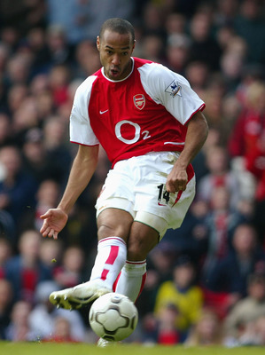 LONDON - APRIL 9:  Thierry Henry of Arsenal scores the third goal for Arsenall during the FA Barclaycard Premiership match between Arsenal and Liverpool at Highbury on April 9, 2004 in London.  (Photo by Mark Thompson/Getty Images)