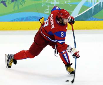 VANCOUVER, BC - FEBRUARY 24: Alexander Ovechkin #8 of Russia controls the puck during the ice hockey men's quarter final game between Russia and Canada on day 13 of the Vancouver 2010 Winter Olympics at Canada Hockey Place on February 24, 2010 in Vancouve