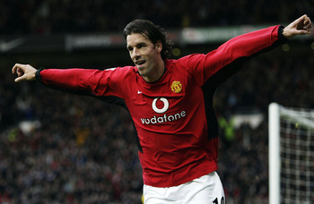 MANCHESTER, ENGLAND - DECEMBER 13: Ruud Van Nistelrooy of Man Utd celebrates after scoring the second goal during the FA Barclaycard Premiership match between Manchester United  and Manchester City at Old Trafford on December 13, 2003 in Manchester, Engla
