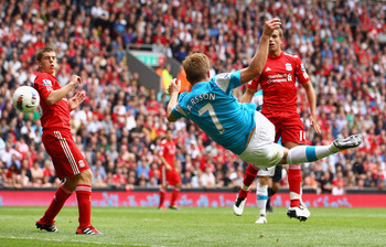 LIVERPOOL, ENGLAND - AUGUST 13:  Sebastian Larsson of Sunderland scores the equalising goal during the Barclays Premier League match between Liverpool and Sunderland at Anfield on August 13, 2011 in Liverpool, England.  (Photo by Clive Brunskill/Getty Ima