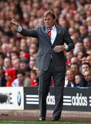 LIVERPOOL, ENGLAND - AUGUST 27:  Liverpool manager Kenny Dalglish directs his team during the Barclays Premier League match between Liverpool and Bolton Wanderers at Anfield on August 27, 2011 in Liverpool, England.  (Photo by Clive Brunskill/Getty Images