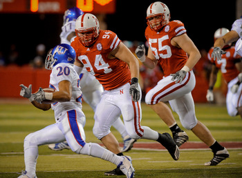LINCOLN, NE - NOVEMBER 13: Jared Crick #94 and Baker Steinkuhler #55 of the Nebraska Cornhuskers run down D.J. Beshears #20 of the Kansas Jayhawks during first half action of their game at Memorial Stadium on November 13, 2010 in Lincoln, Nebraska.  (Phot
