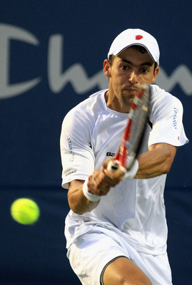 WINSTON-SALEM, NC - AUGUST 24:  Santiago Giraldo of Colombia returns a shot to Andy Roddick of the USA during the Winston-Salem Open at the Wake Forest University Tennis Complex on August 24, 2011 in Winston-Salem, North Carolina.  (Photo by Streeter Leck