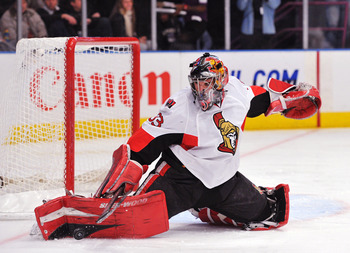 NEW YORK, NY - DECEMBER 5: Pascal Leclaire #33 of the Ottawa Senators deflects a shot on goal during the second period against the New York Rangers at Madison Square Garden on December 5, 2010 in New York City. (Photo by Christopher Pasatieri/Getty Images