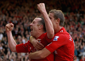 LIVERPOOL, ENGLAND - AUGUST 27:  Charlie Adam of Liverpool celebrates scoring his side's third goal with team mate Jordan Henderson (R) during the Barclays Premier League match between Liverpool and Bolton Wanderers at Anfield on August 27, 2011 in Liverp