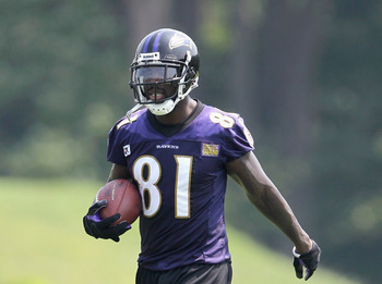 OWINGS MILLS, MD - JULY 29:  Wide receiver Anquan Boldin #81 of the Baltimore Ravens works out during training camp on July 29, 2011 in Owings Mills, Maryland.  (Photo by Rob Carr/Getty Images)